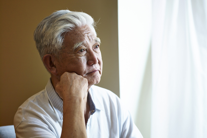 portrait of a sad senior asian man
