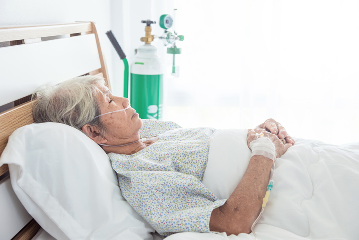senior female patient sleeping on bed