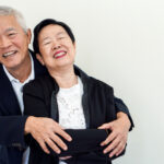 Happy old Asian senior couple. Success in business and life, stay togher forever