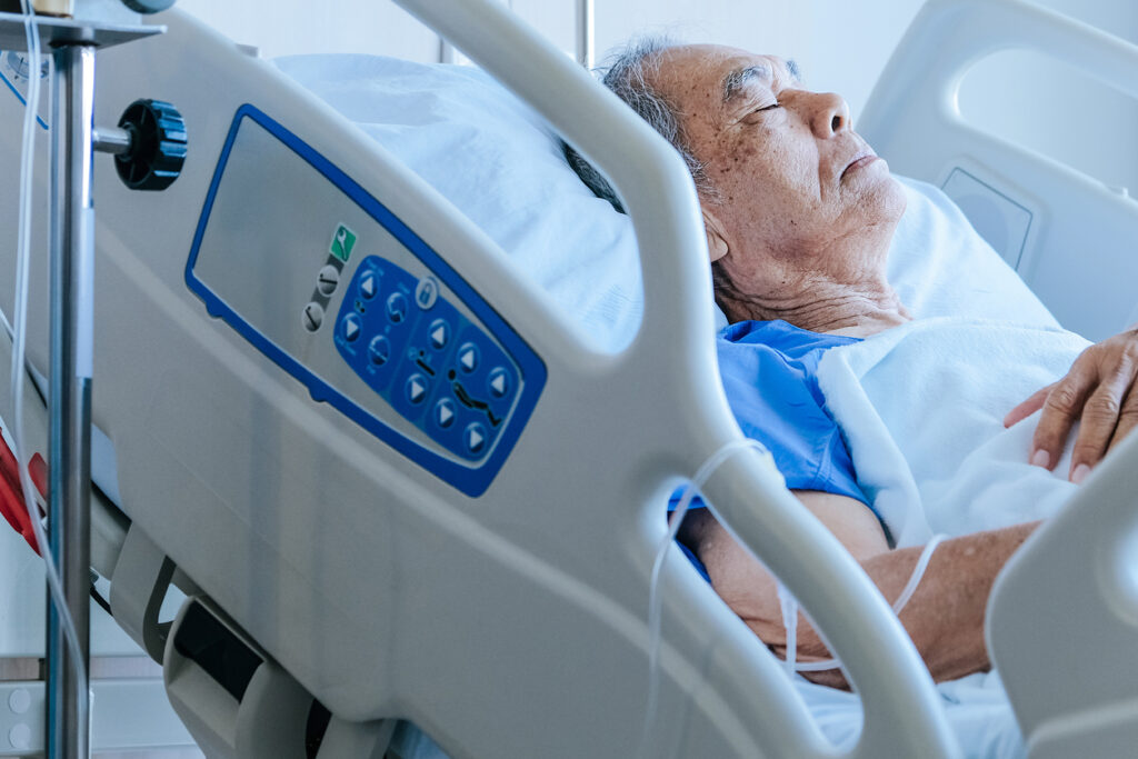 Elderly patients in hospital bed