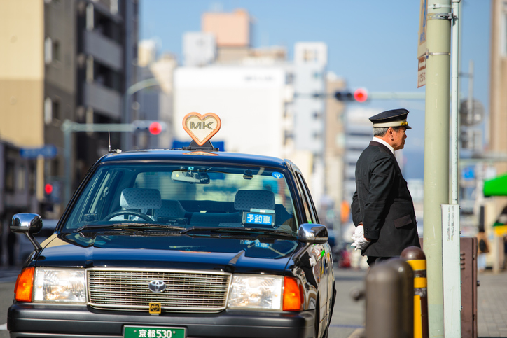 Taxi driver waiting customers in Kyoto