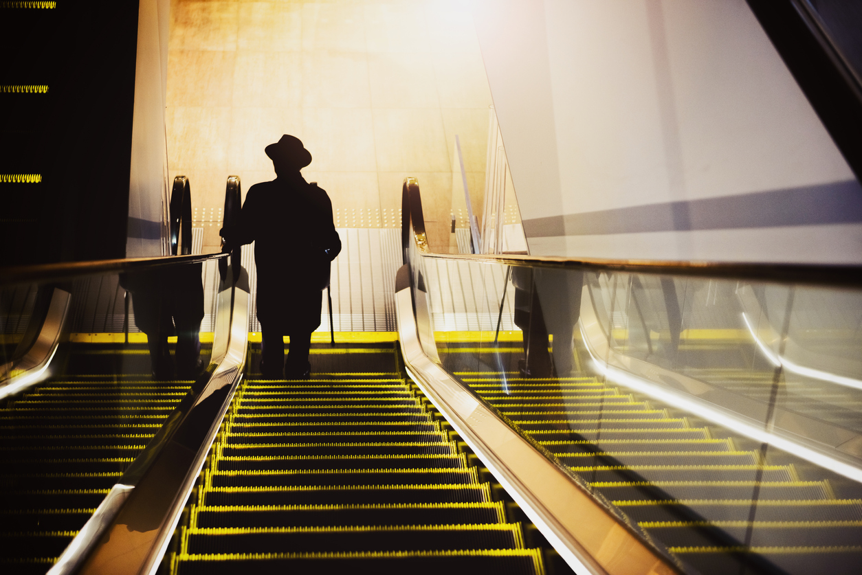 Escalator and old man