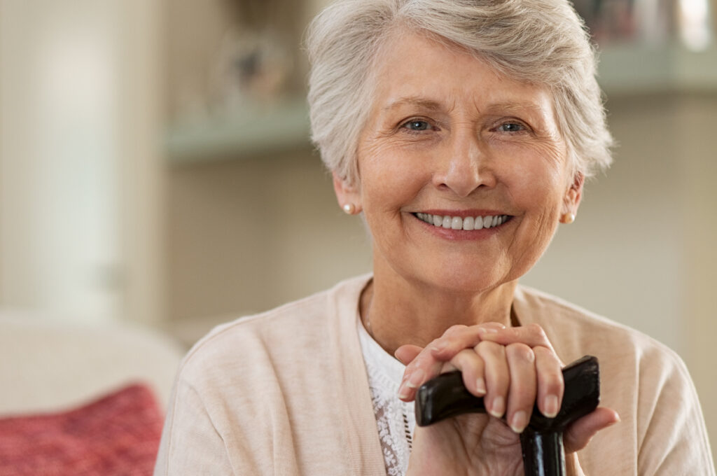 Elderly woman smiling at home