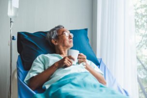 Lonely old asian patient on patient bed in hospital