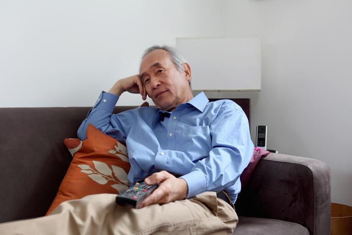 Older man watching television