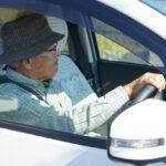 Senior person driving a car