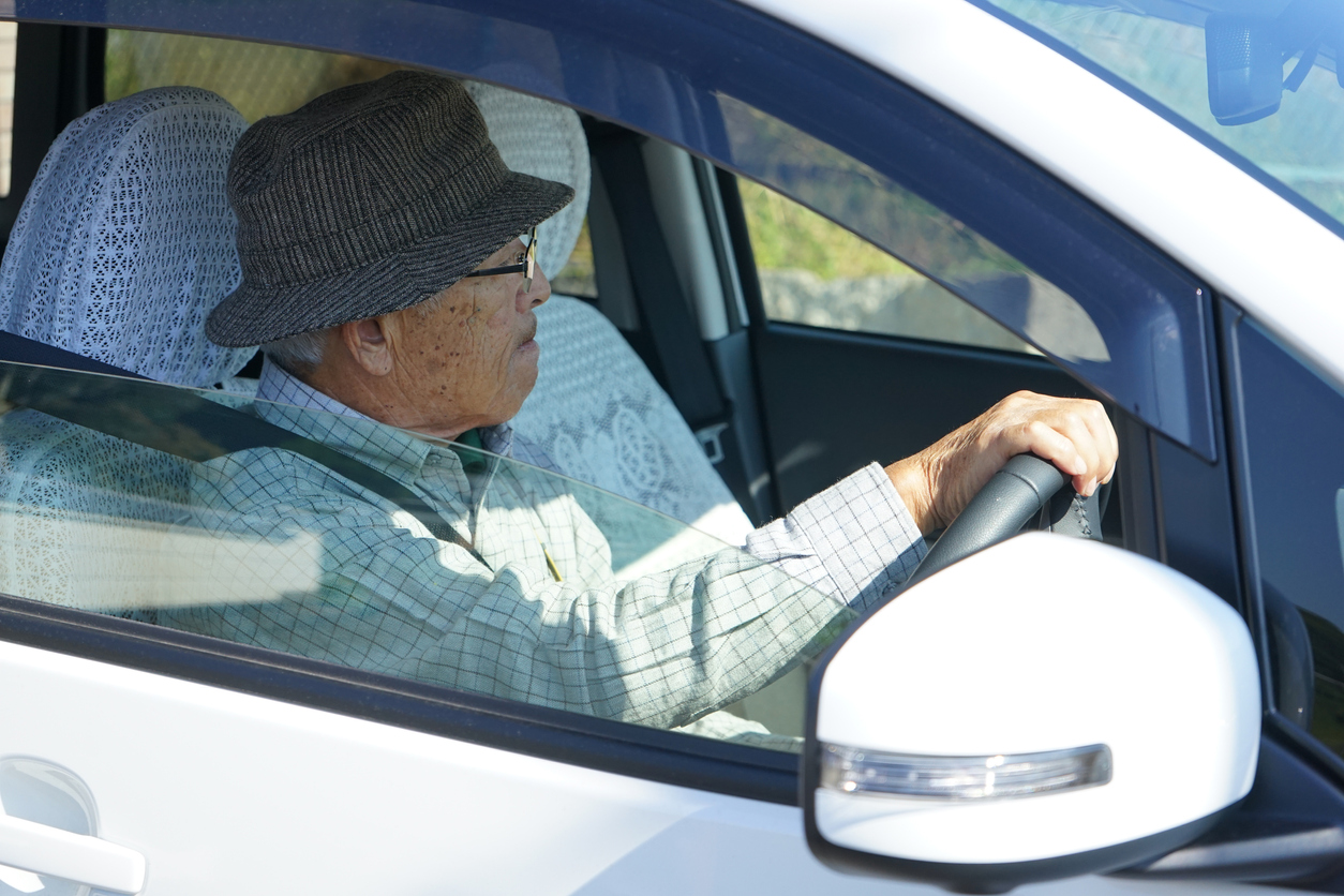 Senior person driving a car