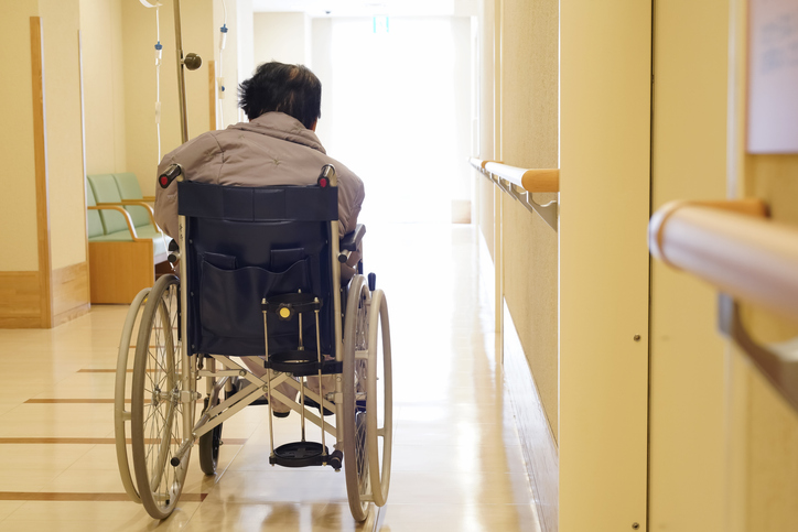 Back view of elderly woman sitting on wheelchair