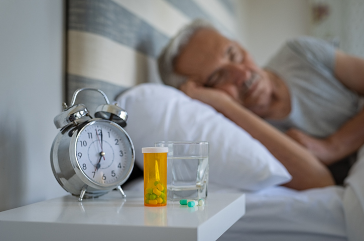 Man sleeping with medicines