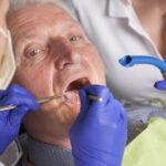 senior man at dental treatment