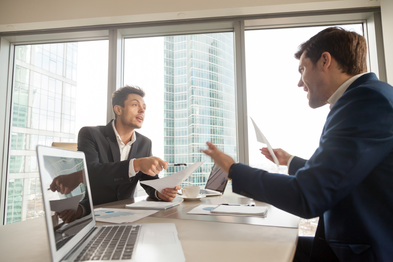 Angry businessman arguing with partner on meeting