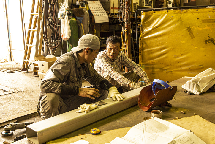 Japanese man working at the iron factory.