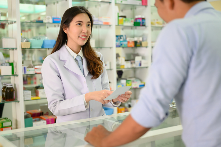 Pharmacist in drug store concept