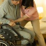 Carer caring for senior man