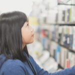 Asian girl in a bookstore