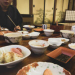 Asian man having traditional japanese breakfest