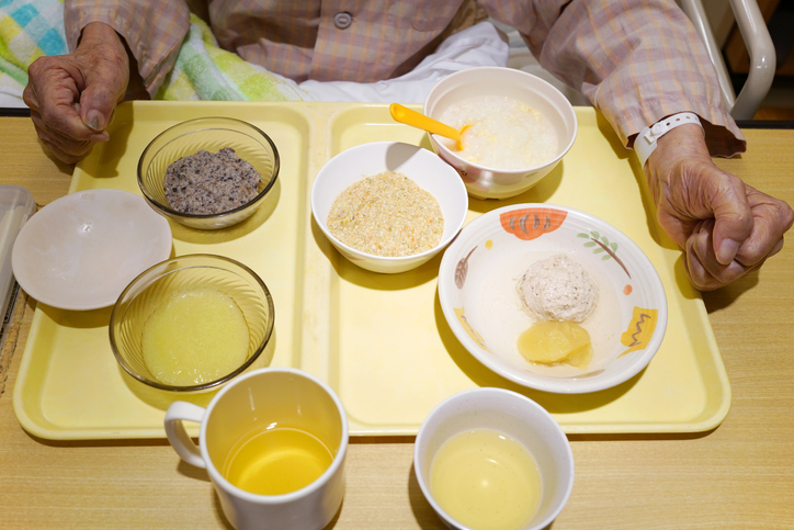 Elderly patient for hospitalization eating food