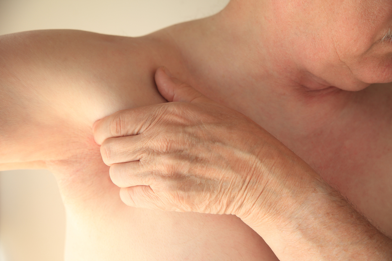 Man with hand near armpit