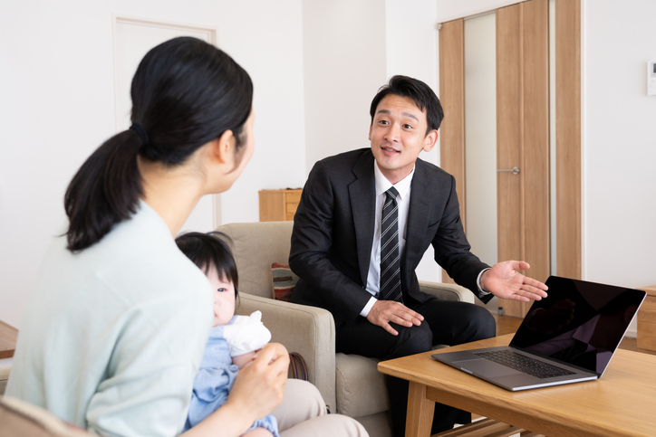asian sales person in living room