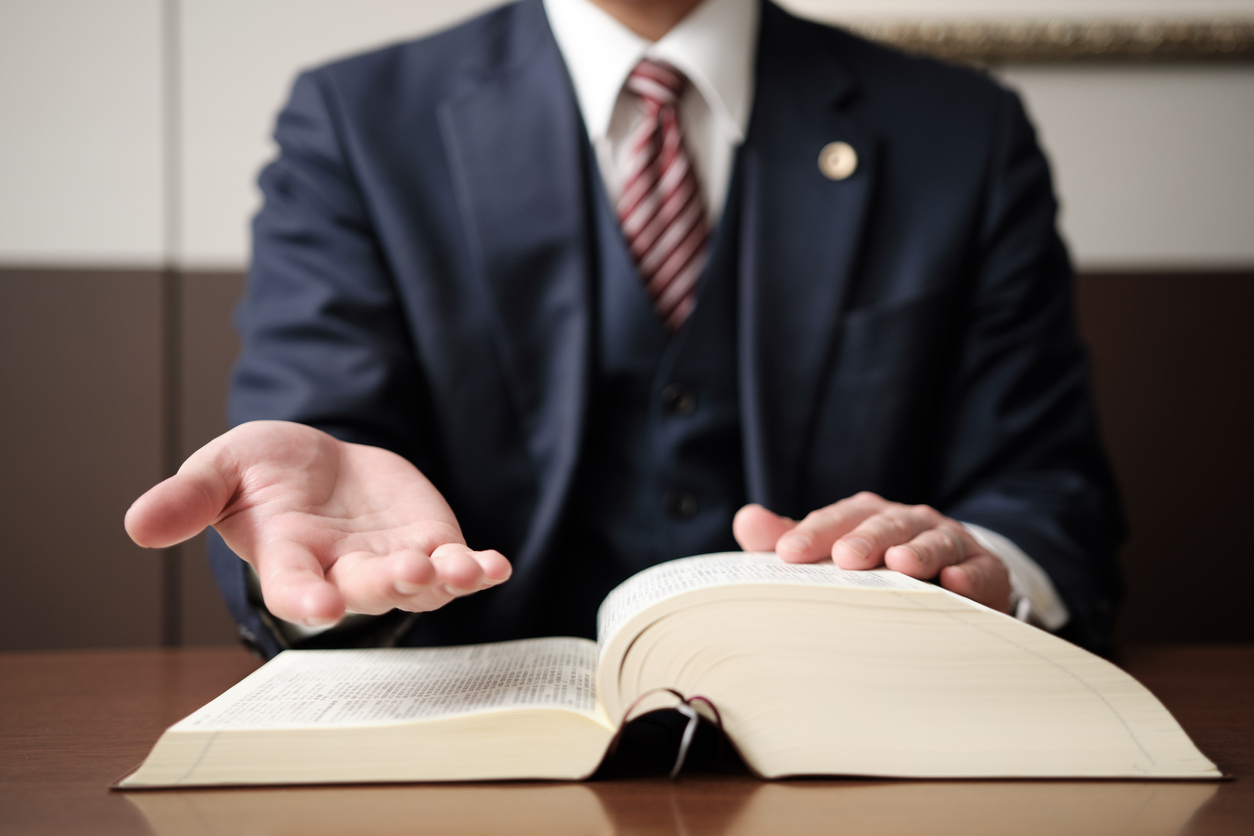 The hand of a lawyer reaching out for salvation