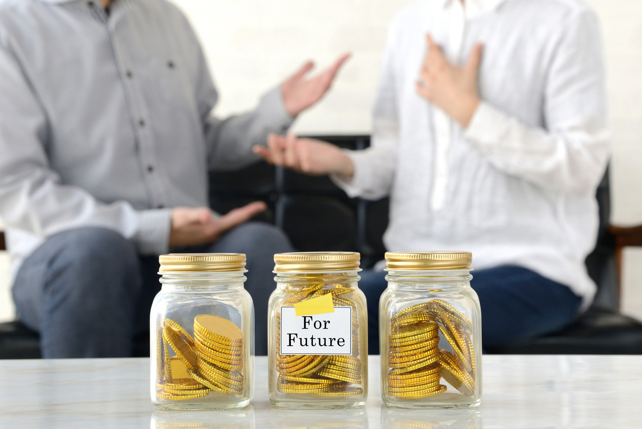 Man and woman thinking about money for future