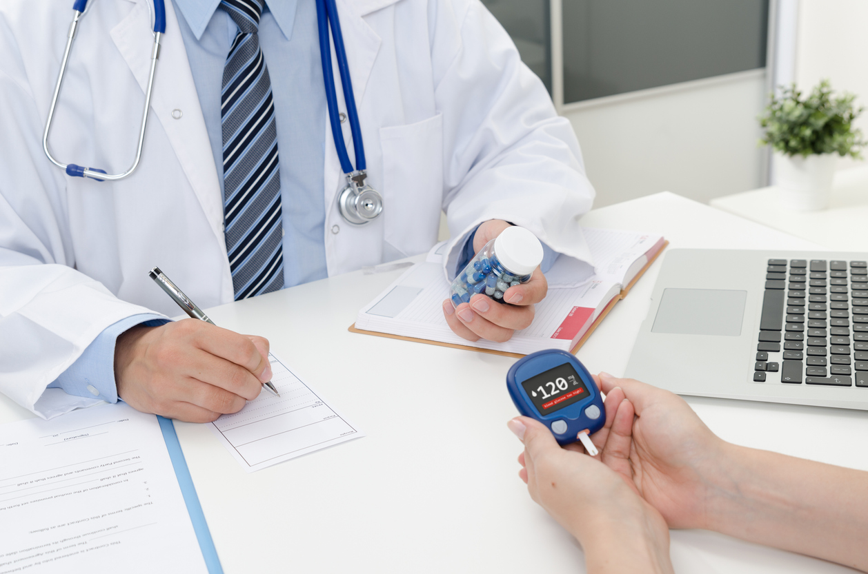 Doctor and patient diabetes consultation in office or clinic.