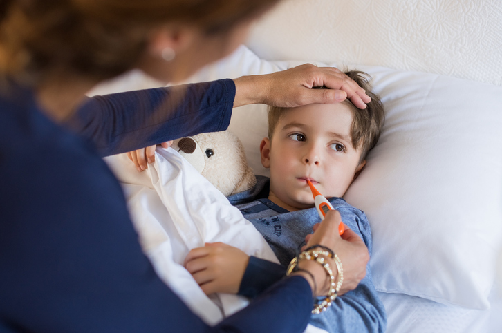 Boy measuring fever