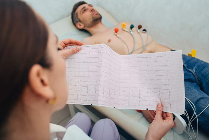 patient getting heart rate monitored at hospital. Close-up Of Ecg Report