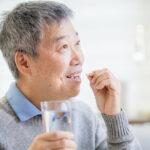 old asian man take medicine