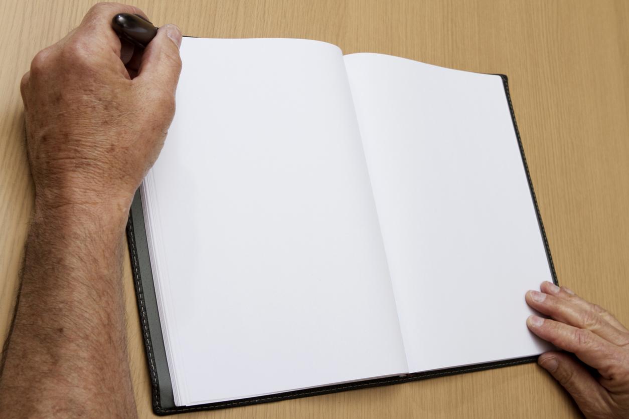 Senior Man Writes in Blank Journal