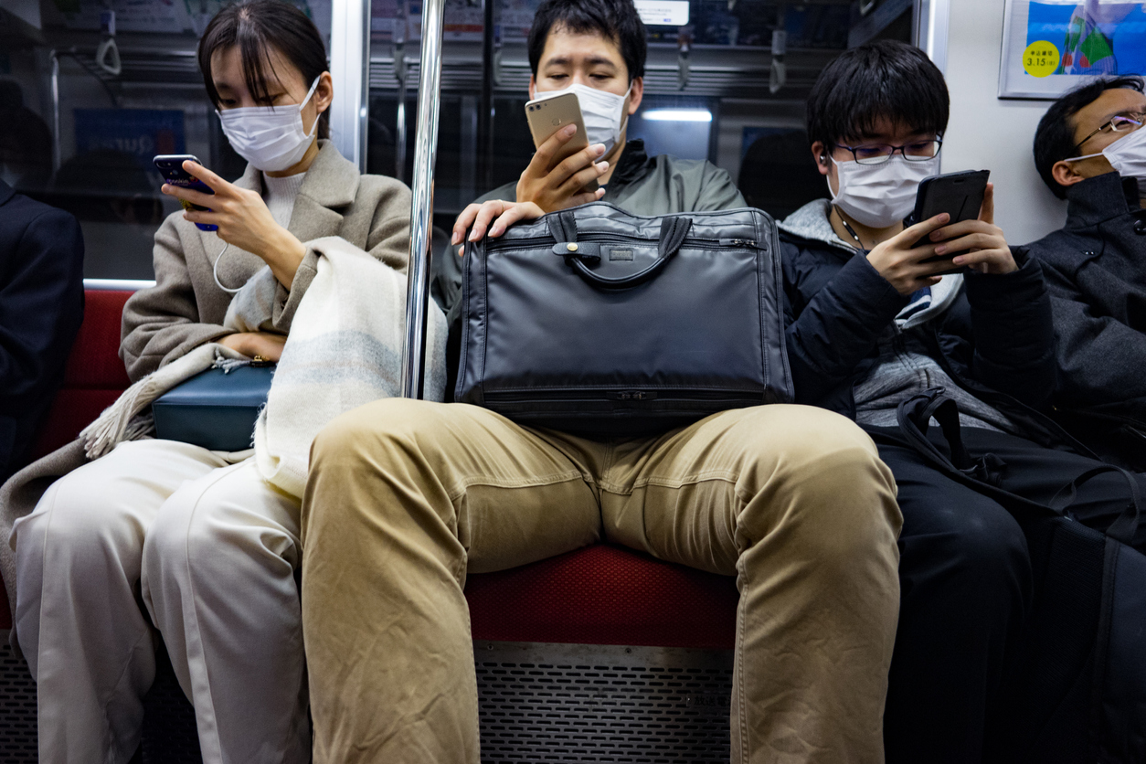 Tokyo commuters wearing facemasks on subway