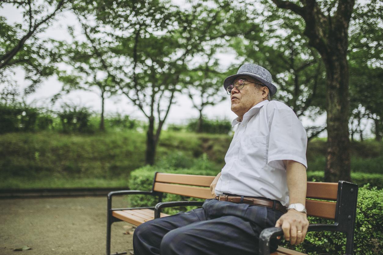 Elderly men resting at the park bench