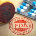 FDA approved concept. Rubber stamp with FDA and pills on craft paper.