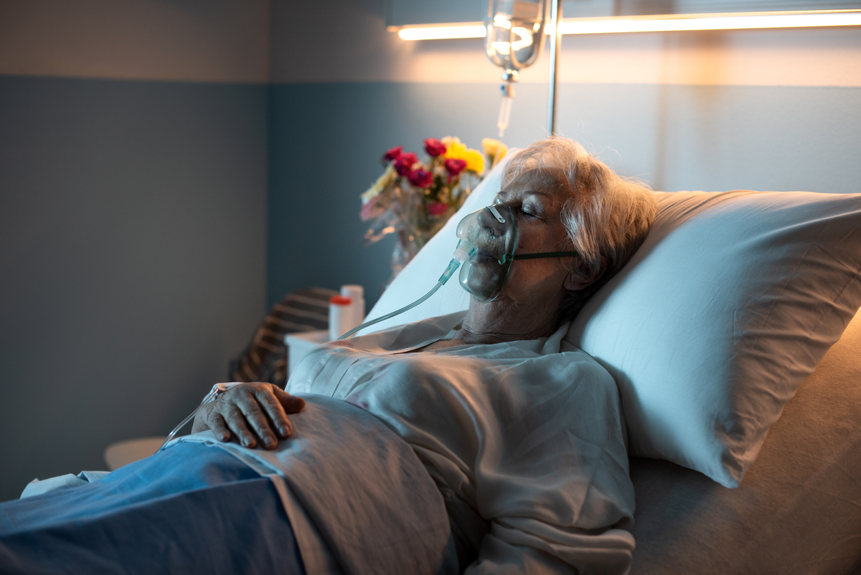 Senior woman lying in bed at the hospital