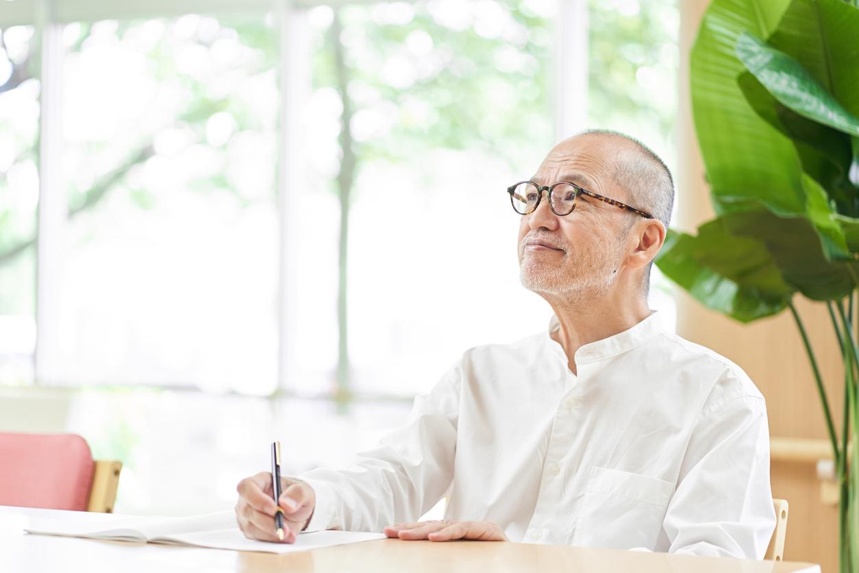 Elderly people writing sentences