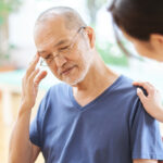 Elderly people with headaches and worried families